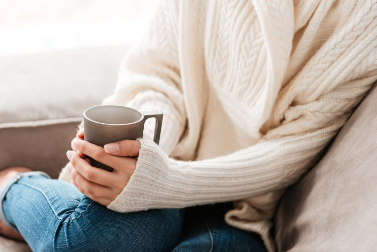 Fotolia_127696293_Woman-with-cup-of-coffee-sitting-on-sofa-at-home_M-e1487948078573