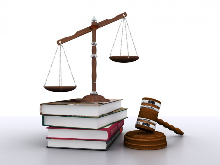 Fotolia_56948361_Scales-of-justice-on-books-beside-gavel_M-e1460736543681