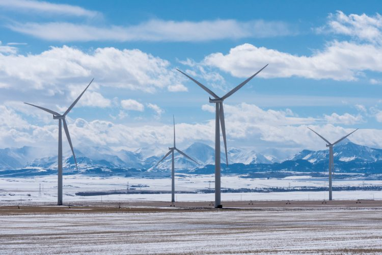 Fotolia_83335859_Wind-Turbines-with-Rocky-Mountains-in-the-Winter_M-e1479329264777