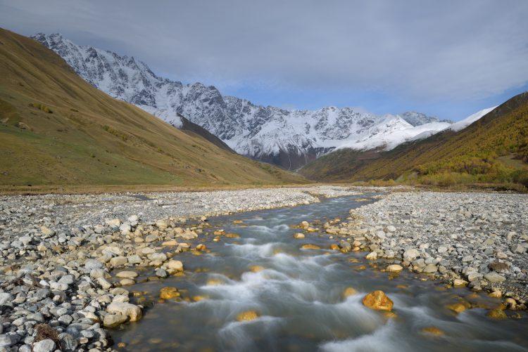 Fotolia_96307083_Landscape-with-a-Mountain-River_M-e1465482112740