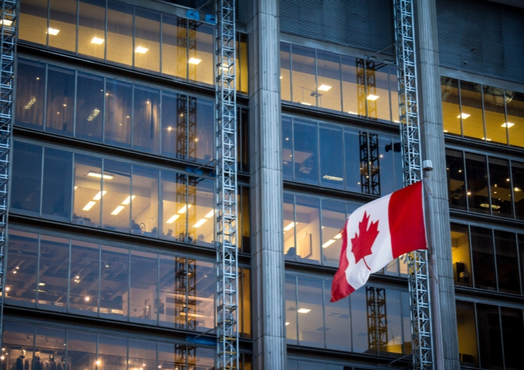 Canadian flag in front of building