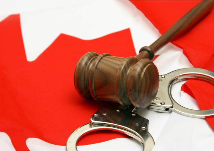 gavel with Canadian flag and handcuffs