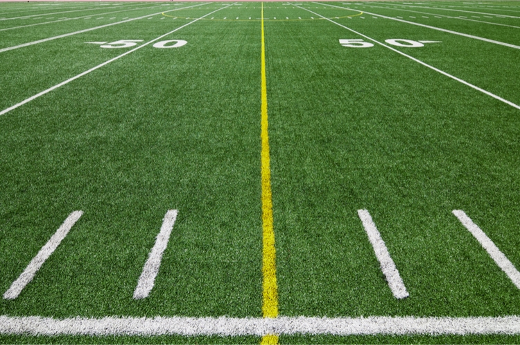 shutterstock_114589507_yellow line on football field-web