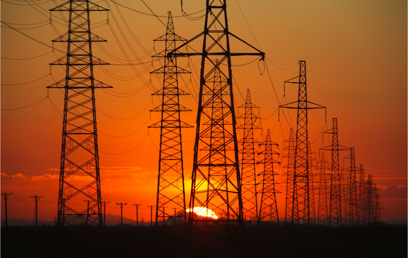 shutterstock_118421803_transmission lines at sunset