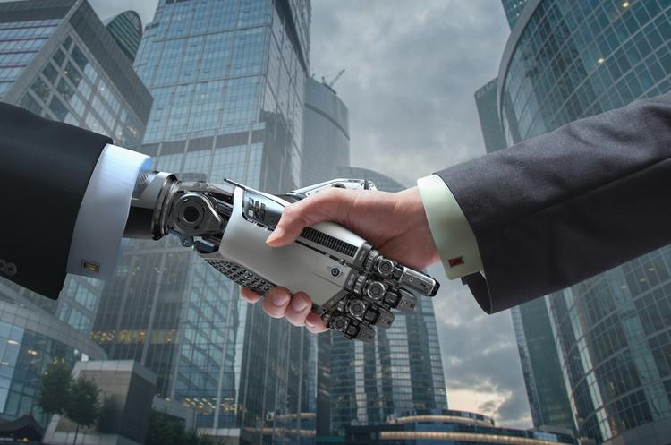 shutterstock_436945282_artificial intelligence handshake_web