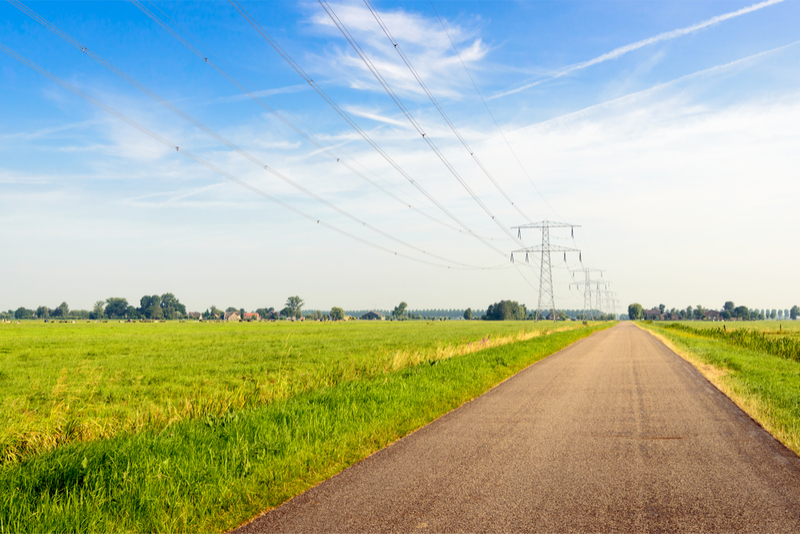 shutterstock_461133688_transmission lines in rural area EI