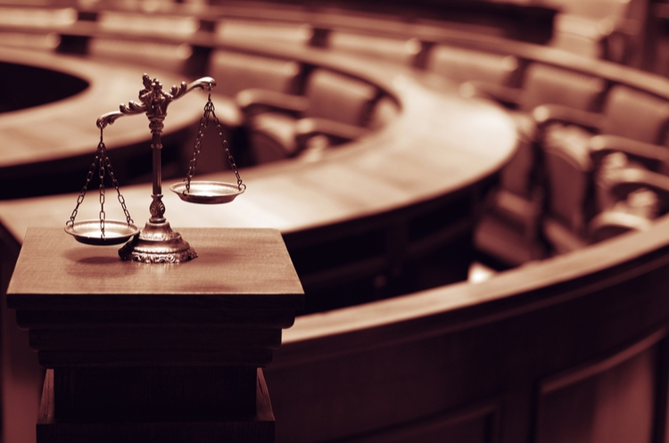 shutterstock_465586604_courtroom and scales of justice_web