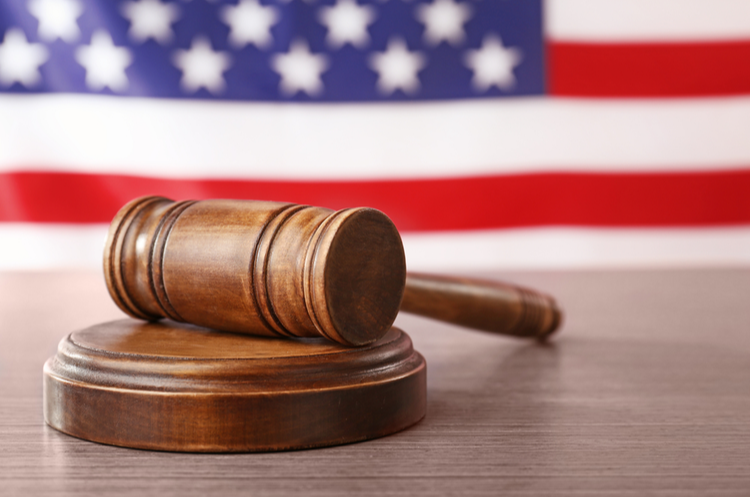 Gavel with US flag in background