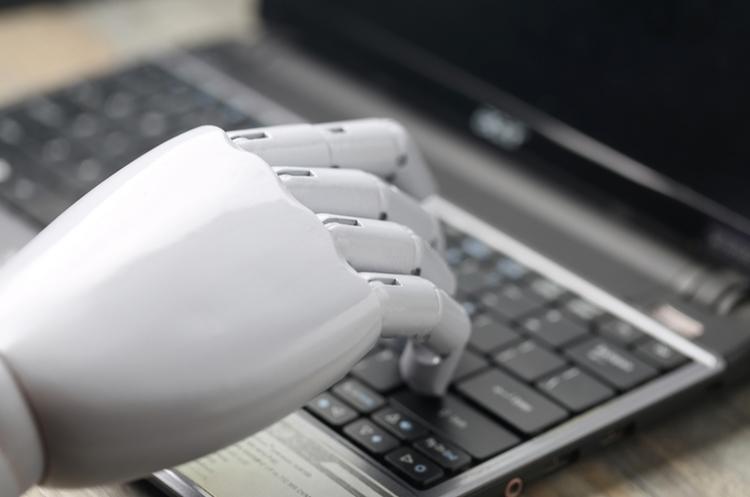 shutterstock_539711092_artificial intelligence hand on keyboard_web