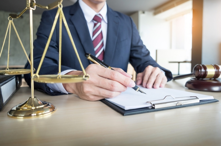 shutterstock_678458245_lawyer at a desk_web