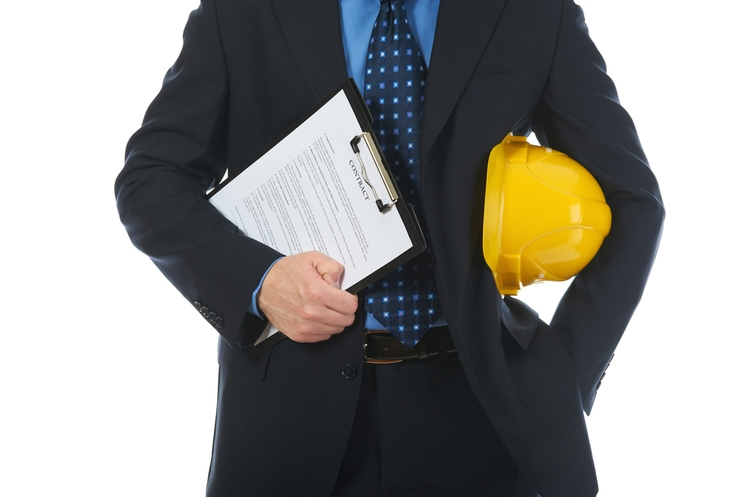shutterstock_70128745business worker with hardhat_web