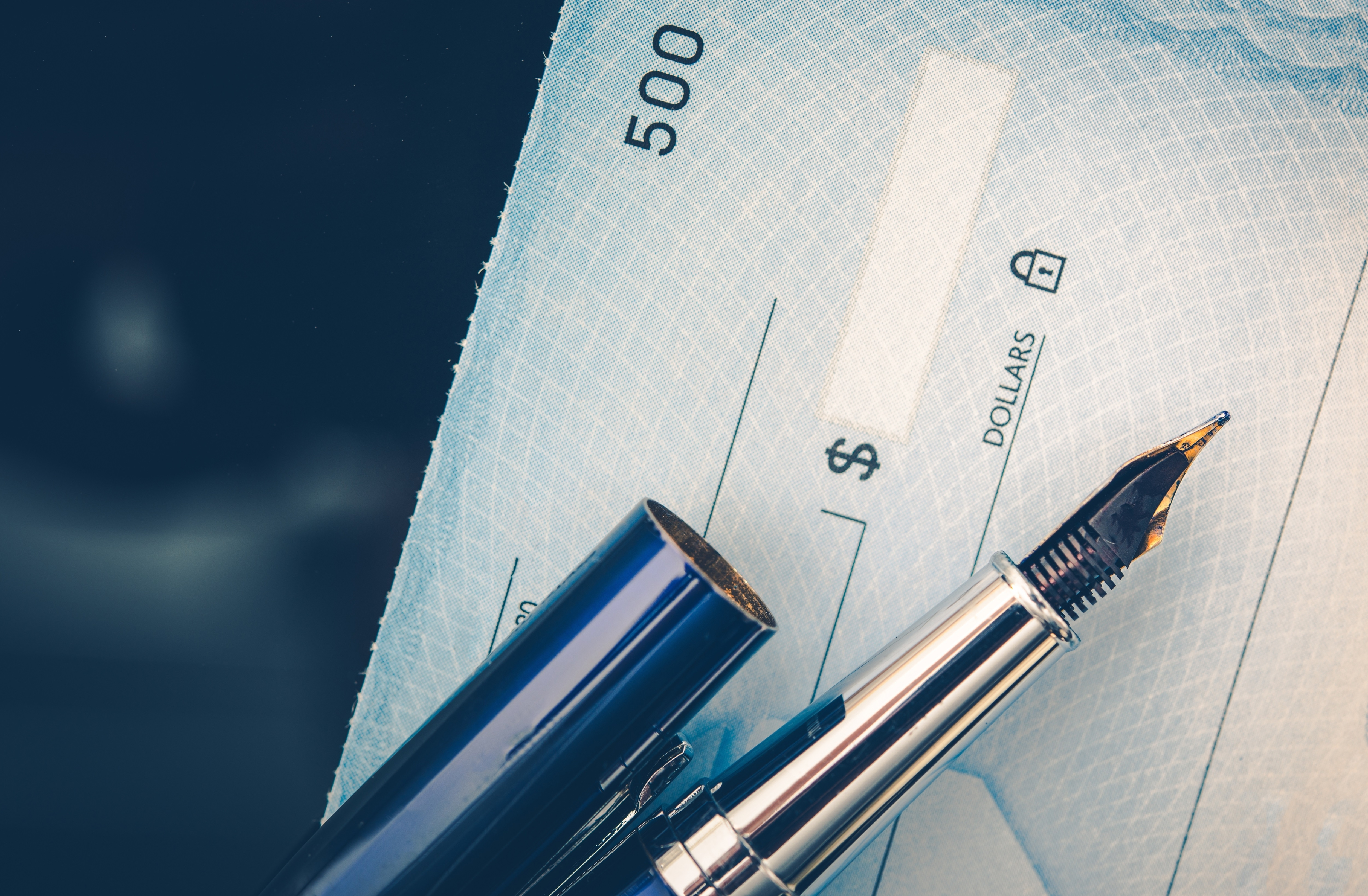 shutterstock_cheque and pen