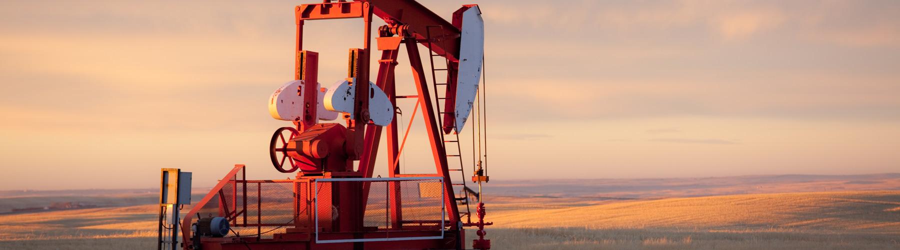 Red Prairie pump jack in oil field