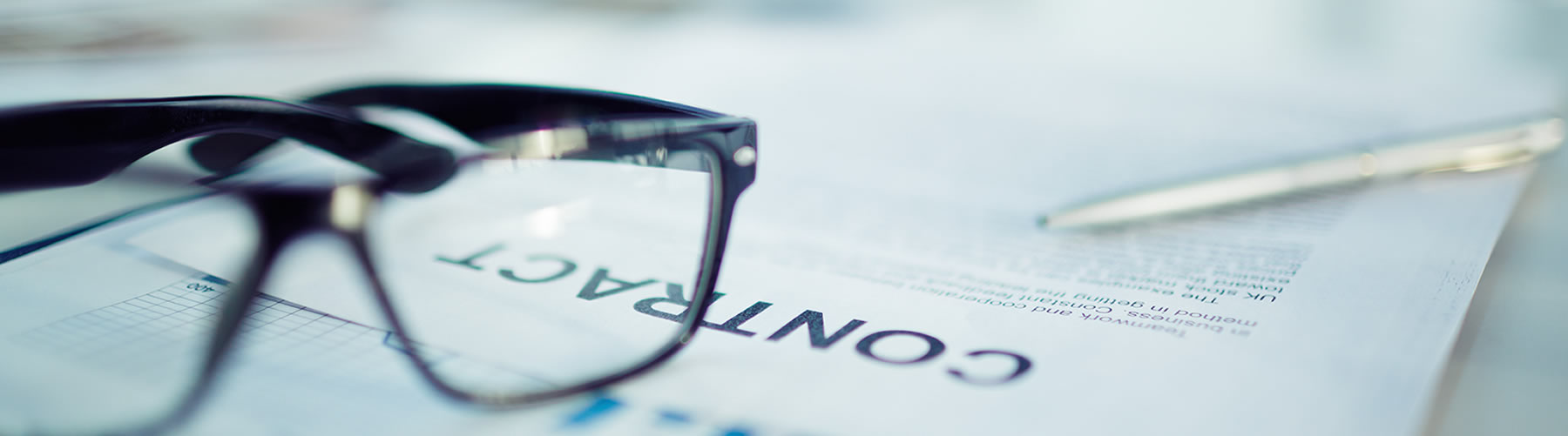 business documents with glasses on the table